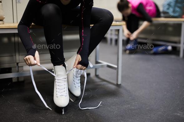 Girl Tying Ice Skates Closeup - Stock Photo - Images