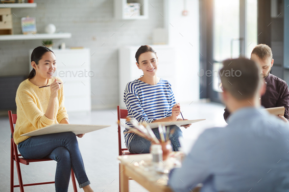 Listening to teacher of painting - Stock Photo - Images