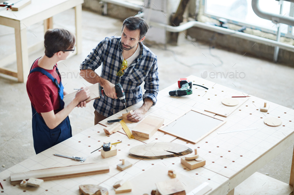 Showing how to make hole in wooden piece - Stock Photo - Images