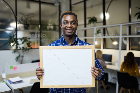 Black man showing blank banner - Stock Photo - Images