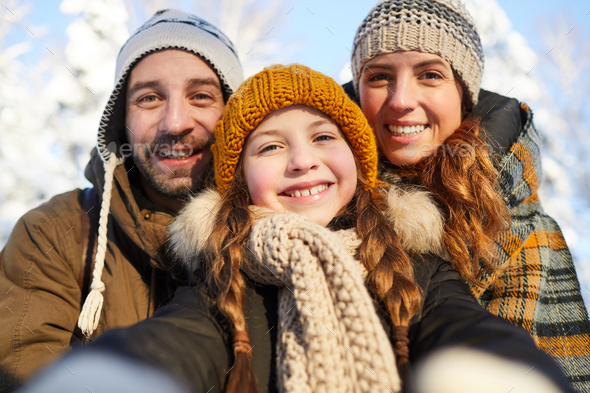 Family Taking Selfie in Winter - Stock Photo - Images
