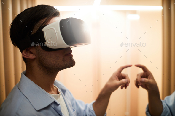Guy in virtual reality - Stock Photo - Images