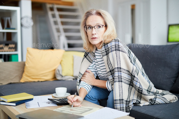 Woman Filling Forms at Home - Stock Photo - Images