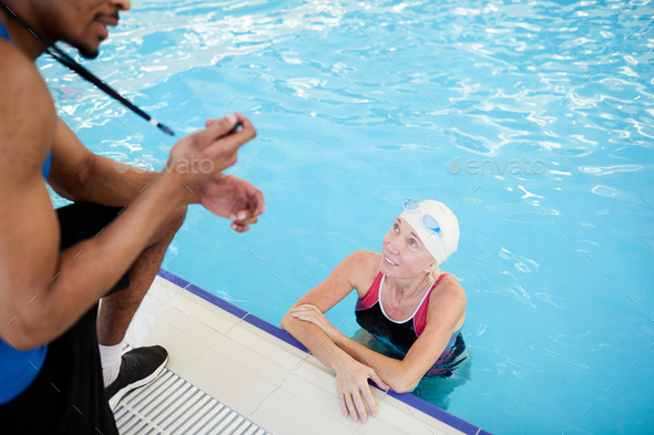 Client in Swimming Pool - Stock Photo - Images