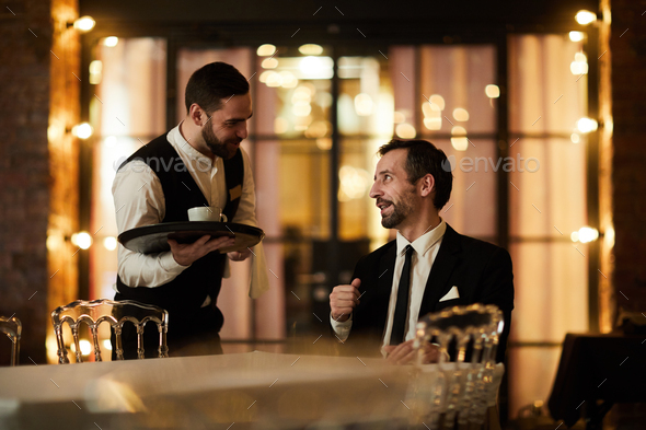 Waiter Bringing Coffee to Client - Stock Photo - Images