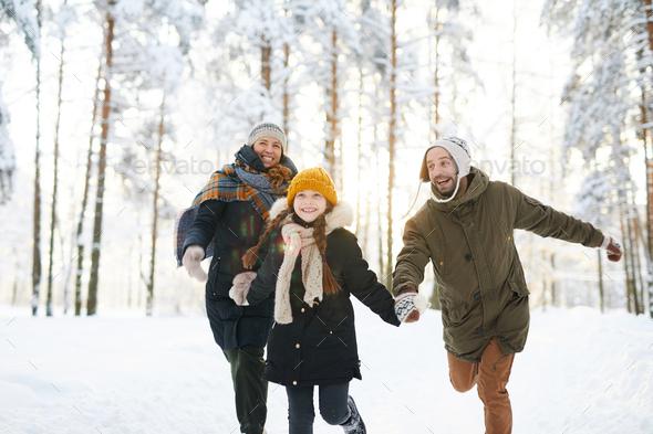 Carefree Family Enjoying  Winter - Stock Photo - Images
