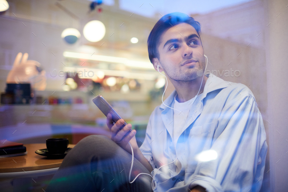 Guy listening to music - Stock Photo - Images