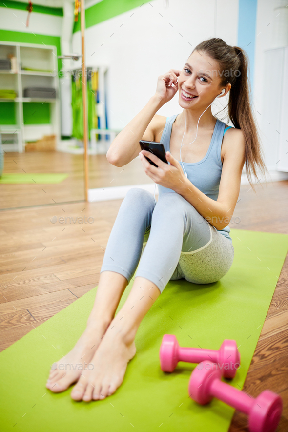 Smiling Woman Taking Break from Workout - Stock Photo - Images