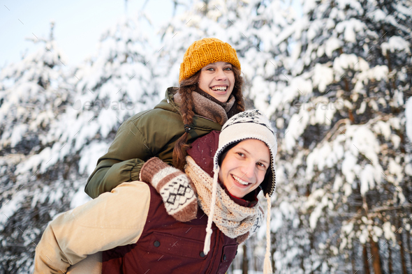 Couple having Fun in Winter - Stock Photo - Images