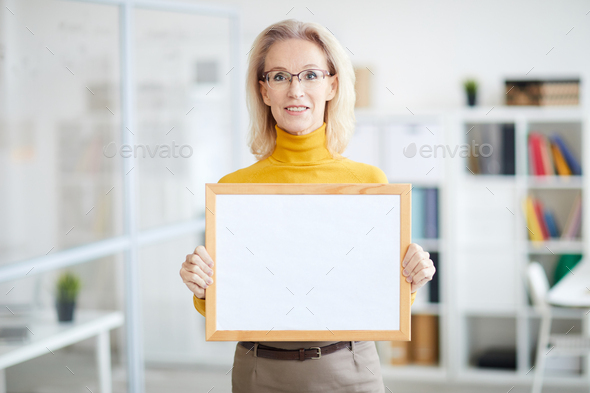 Businesswoman Holding Blank Sign - Stock Photo - Images