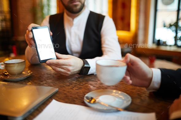 Businessman Showing Mobile Phone - Stock Photo - Images
