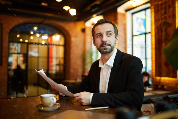 Mature Businessman in Cafe - Stock Photo - Images