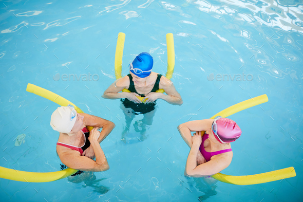 Three Mature Women Relaxing in Pool - Stock Photo - Images
