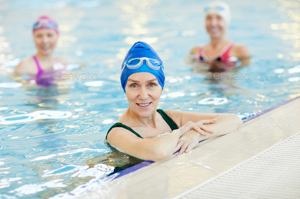 Smiling Adult Woman Posing in Pool - Stock Photo - Images
