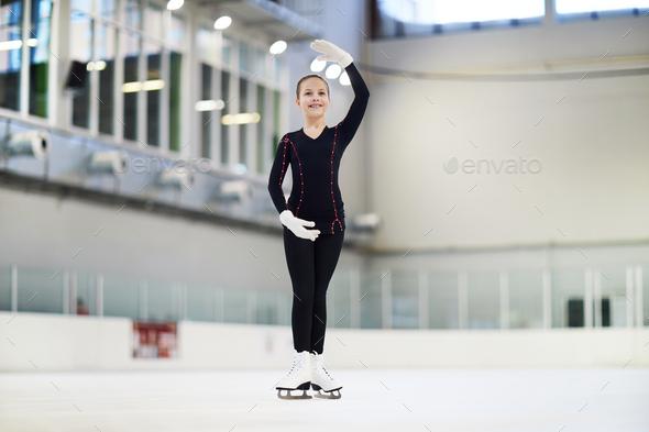 Little Figure Skater Posing in Rink - Stock Photo - Images