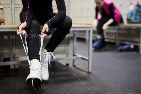 Unrecognizable Girl Tying Ice Skates - Stock Photo - Images