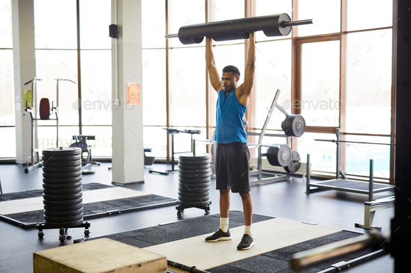 Lifting heavy barbell - Stock Photo - Images