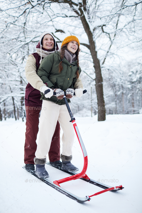 Couple Riding Sleigh - Stock Photo - Images