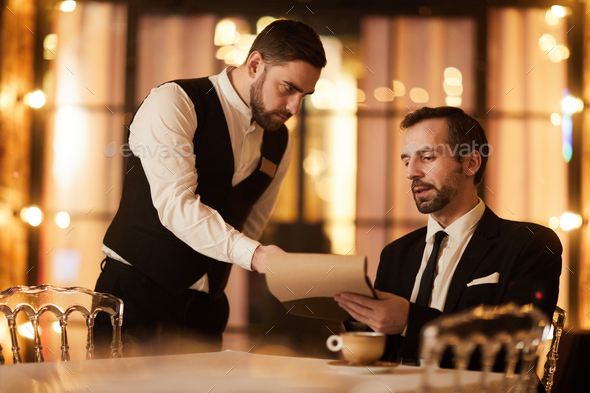 Rich Man Ordering Food in Restaurant - Stock Photo - Images