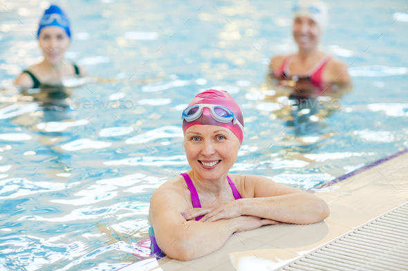 Smiling Mature Woman Posing in Pool - Stock Photo - Images