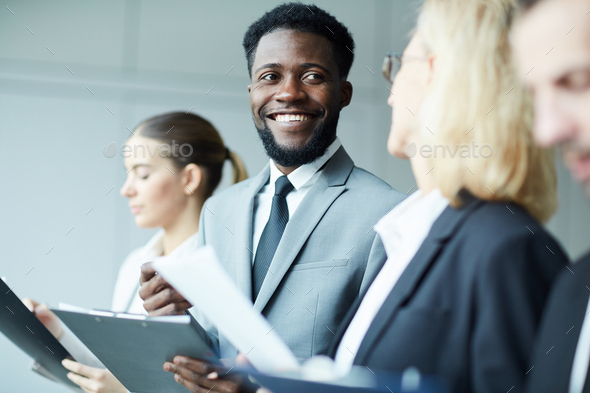 Talking while making notes - Stock Photo - Images