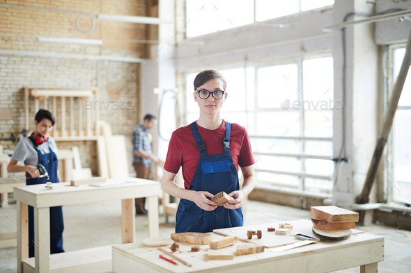 Young carpenter working with wood - Stock Photo - Images