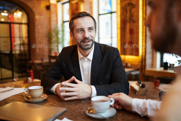 Handsome Businessman in Cafe - Stock Photo - Images
