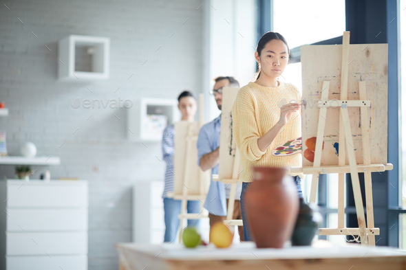 Girl painting still life - Stock Photo - Images