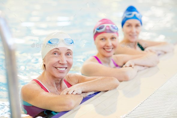 Three Mature Women Posing in Pool - Stock Photo - Images