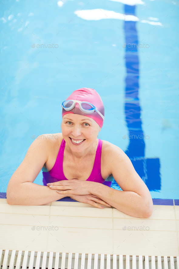 Happy Mature Woman Posing in Pool - Stock Photo - Images