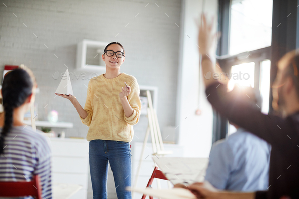 Teacher with pyramid - Stock Photo - Images