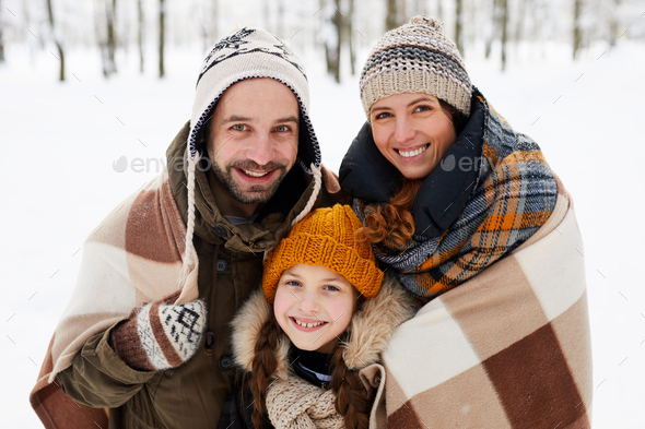 Happy Family Posing in Winter Forest - Stock Photo - Images