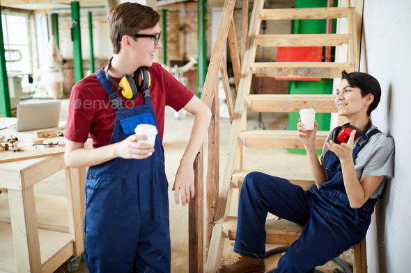 Young carpentry workers chatting during break - Stock Photo - Images