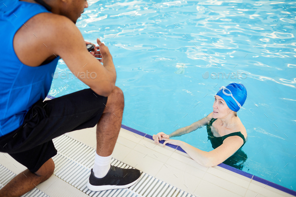 Mature Woman in Aqua Fitness Class - Stock Photo - Images