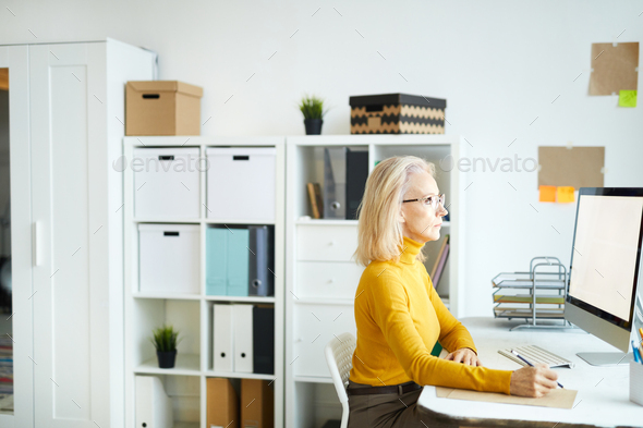 Mature Businesswoman Using Computer - Stock Photo - Images