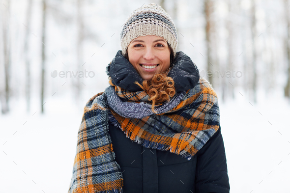 Smiling Young Woman Enjoying Winter - Stock Photo - Images