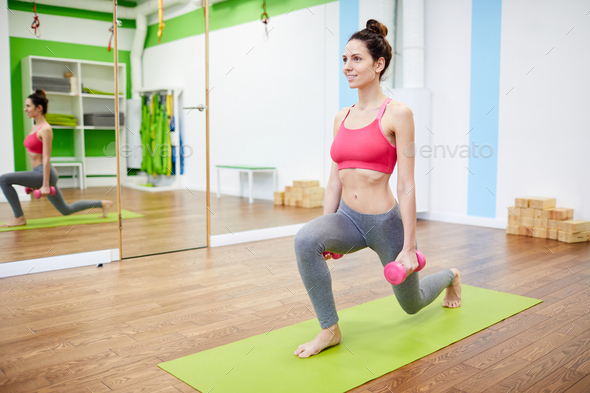 Woman Working out with Dumbbells - Stock Photo - Images