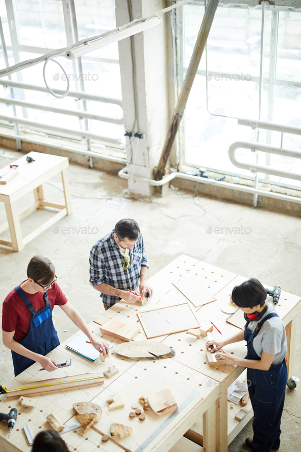 Busy carpenters producing furniture - Stock Photo - Images