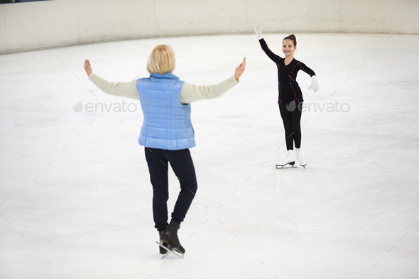 Coach Training Little Figure Skater - Stock Photo - Images