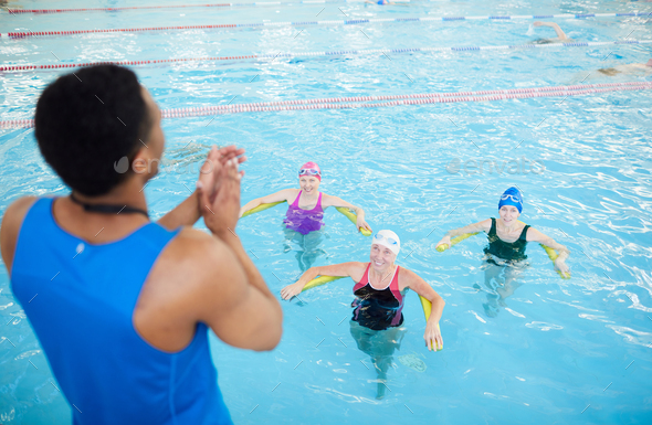 Fitness Class in Swimming Pool - Stock Photo - Images