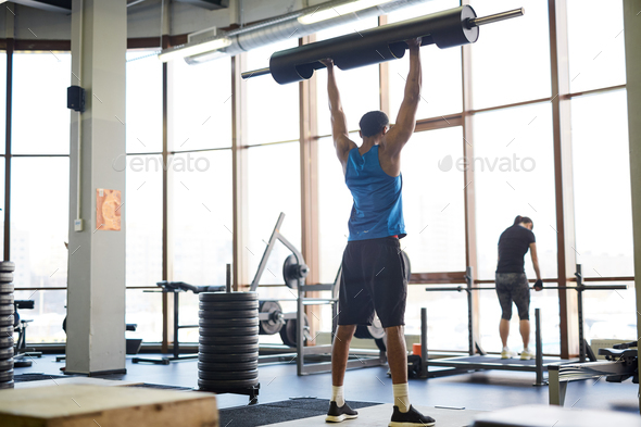 Lifting barbell - Stock Photo - Images