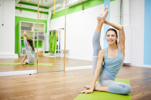 Flexible Young Woman in Health Club - Stock Photo - Images