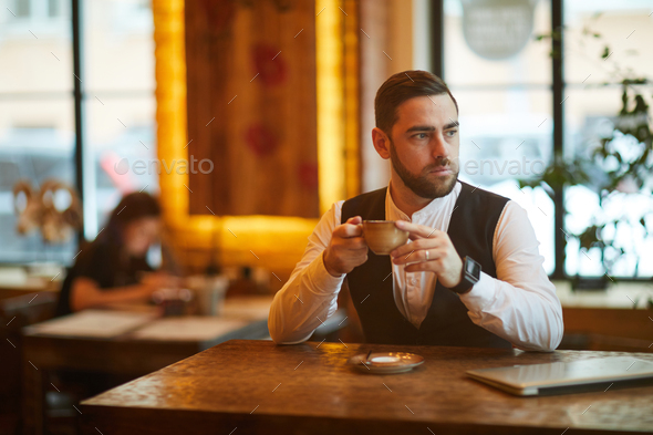 Businessman in Cafe on Coffee Break - Stock Photo - Images