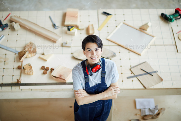 Cheerful lady carpenter in own workshop - Stock Photo - Images