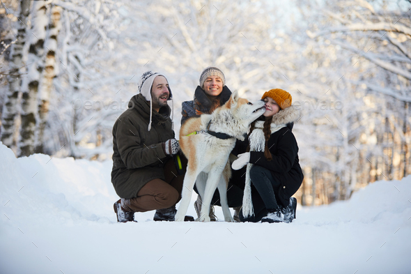 Happy Family with Dog Outdoors - Stock Photo - Images
