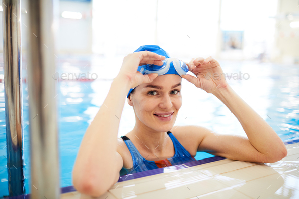 Smiling Woman in Swimming Pool - Stock Photo - Images