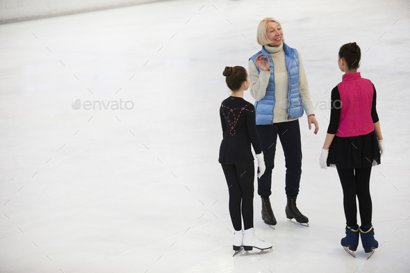 Coach Training Figure Skaters - Stock Photo - Images
