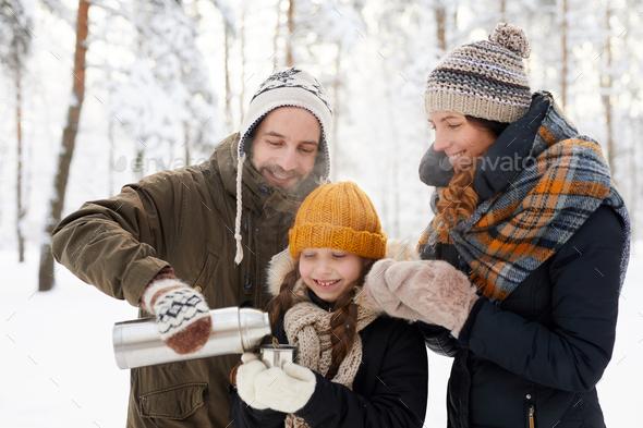 Happy Family Drinking Tea  Winter - Stock Photo - Images