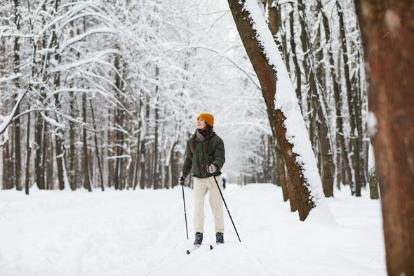 Active Woman Skiing in Forest - Stock Photo - Images