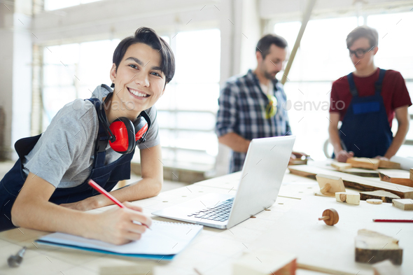 Excited lady enjoying work in carpentry - Stock Photo - Images
